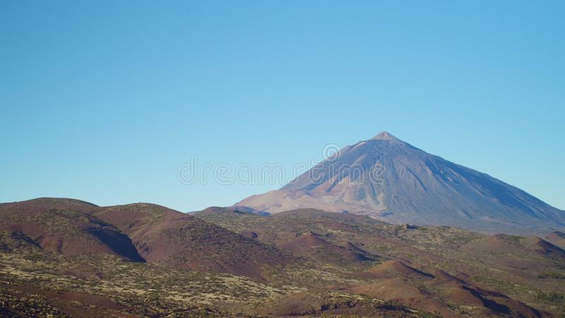 Panorama of the volcanic landscape on a clear day at dawn stock photography