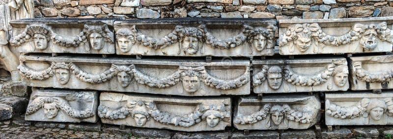 Panorama von griechischen Masken stockfotos