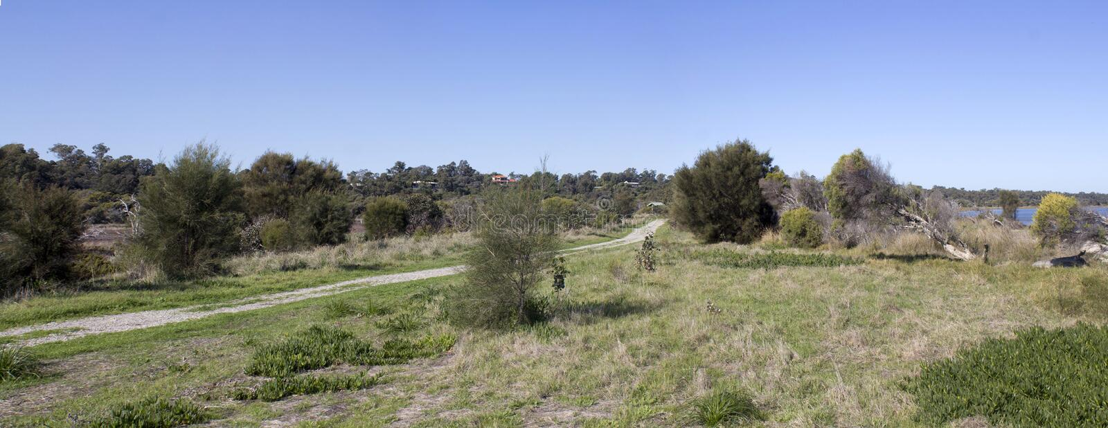 Panorama of the walkpath along the Leschenault Estuary Bunbury Western Australia . The panoramic view of the environment around the shallow Leschenault Estuary stock photos