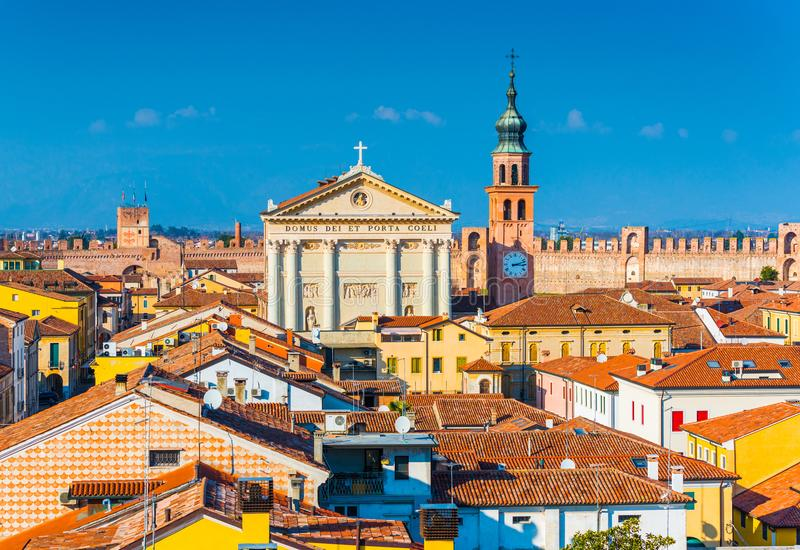 Panorama of the walled city of Cittadella. Cityscape of the medieval Italian town. Text on the cathedral in Latin: Temple of Heaven and the Gate Province of royalty free stock photo