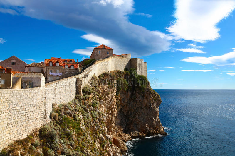 Panorama of walls which is defending old Dubrovnik. Defense wall of Old town of Dubrovnik in Croatia with beautiful view of Adriatic sea royalty free stock images