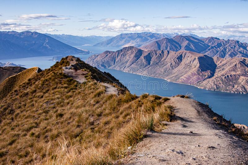Wanaka lake and the trail leading to the observation point royalty free stock images