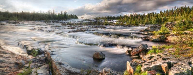 Panorama Waterfall Trappstegsforsen - Sweden. Waterfall Trappstegsforsen in the morning (North Sweden near Vilhelmina royalty free stock photo