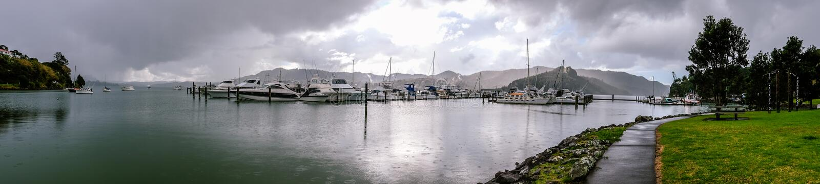 Panorama of Whangaroa Harbour marina on a rainy day in Northland, New Zealand, NZ. Panorama of Whangaroa Harbour boat marina on a rainy overcast day in Northland stock images