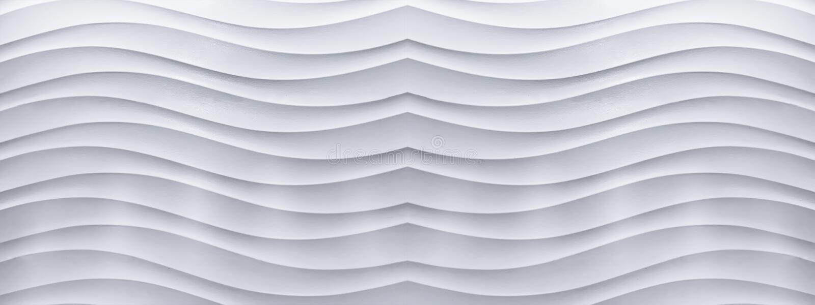 Panorama of white concrete wall with a wave line pattern. Panorama background of white concrete wall with a wave line pattern like a bird's wings stock images