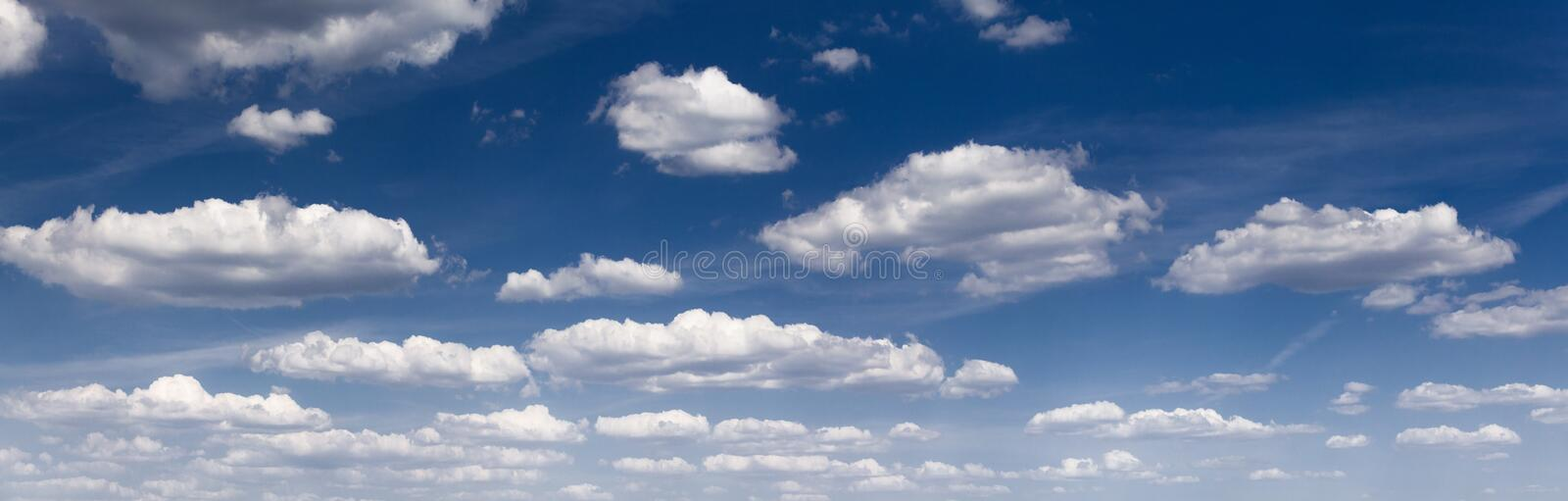 Panorama of the white fluffy clouds royalty free stock photography