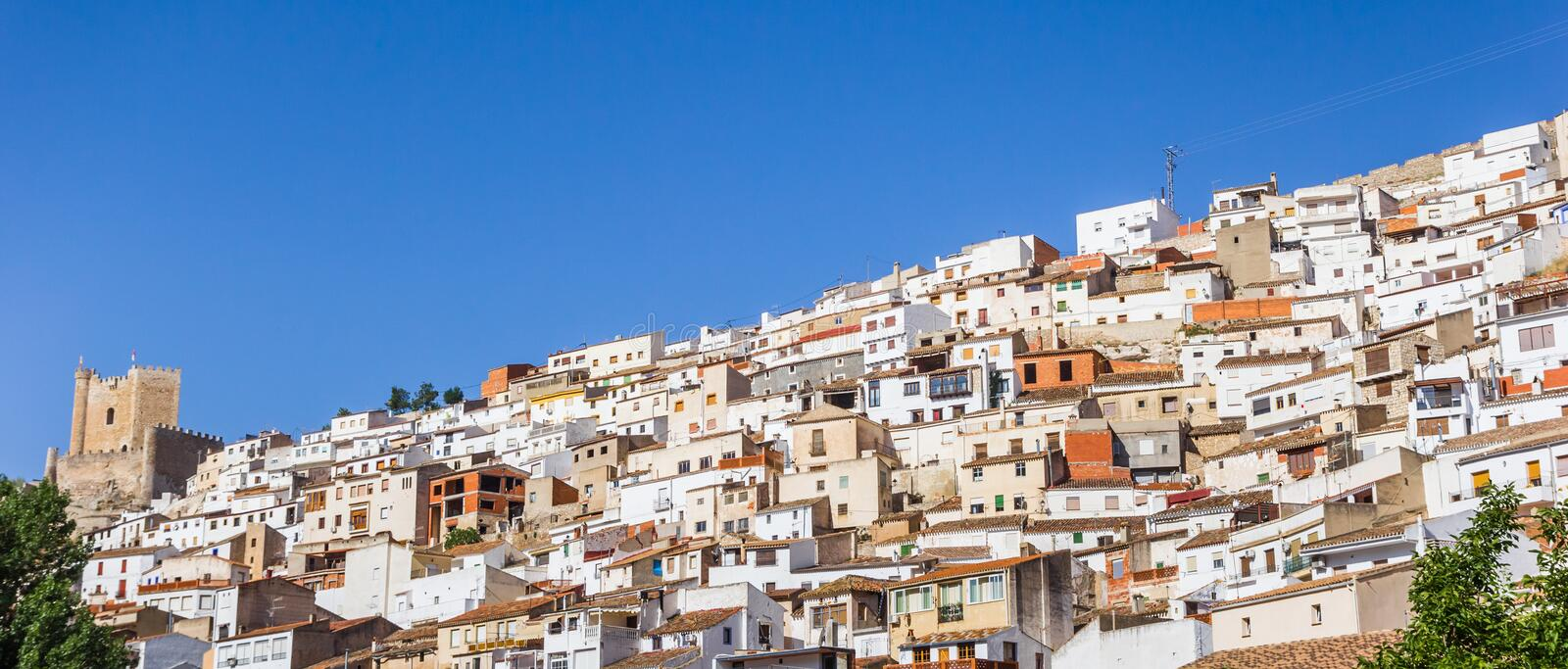 Panorama of white houses and castle in Alcala del Jucar. Spain royalty free stock photography