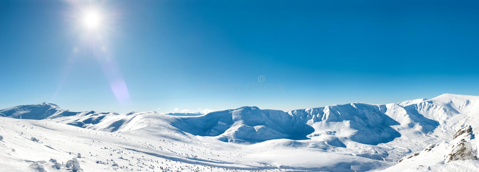 Panorama of white winter mountains royalty free stock images