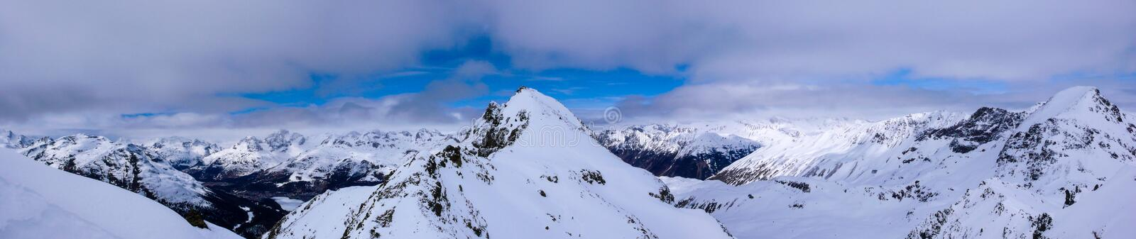 Panorama winter mountain landscape with peaks and the lakes near St. Moritz in the background royalty free stock photography