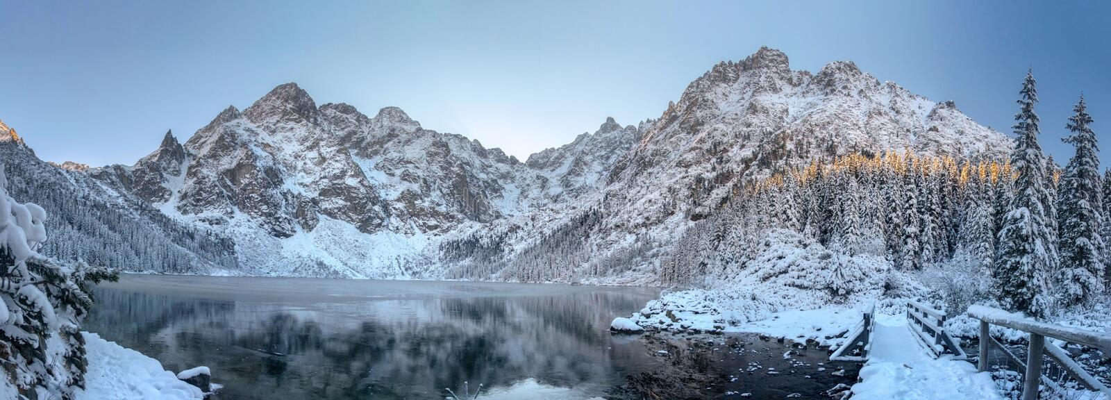 Panorama winter mountains. Scenery winter. Beautiful frosty and snowy nature. Ice mountain lake. winter landscape. Panoramic view stock photography