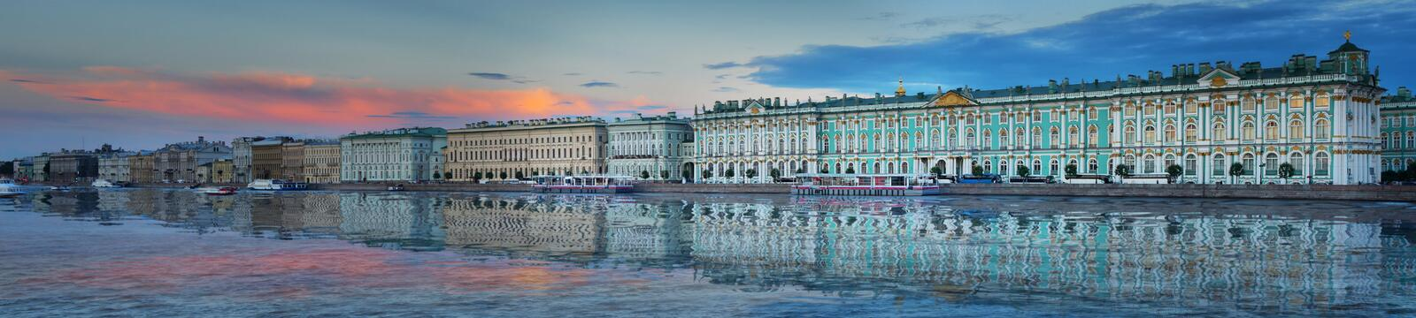 Panorama of the Winter Palace and the Hermitage at dusk sunset in St. Petersburg. Large-format panorama of the Neva river, the Palace embankment and the royalty free stock photo