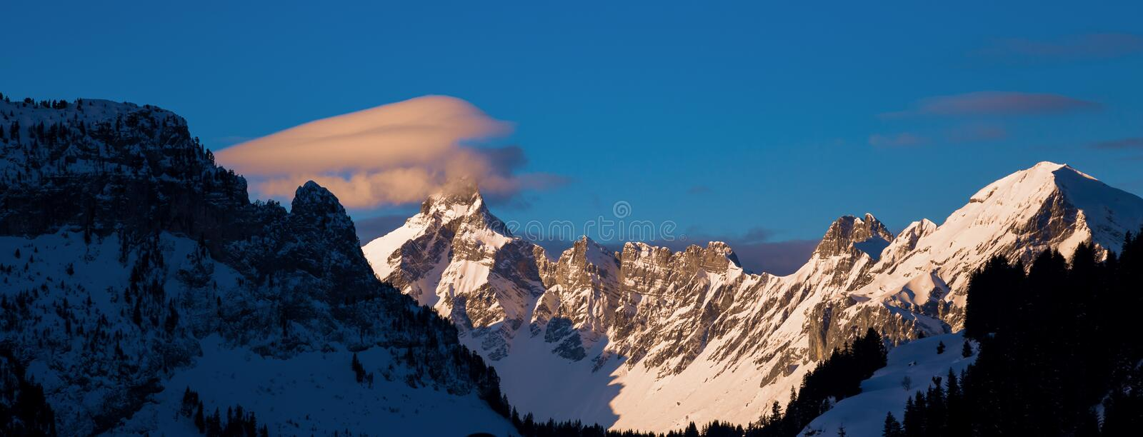 Panorama of winter snowy Alps. Colored sky at sunset sunset in snowy mountains. Flaine, Grand Massif, France stock images
