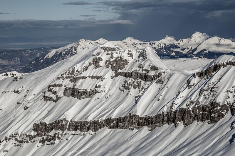 Panorama of winter snowy Alps. Panorama with dramatic sky, Alps in Flaine area, Grand Massif, France stock photo