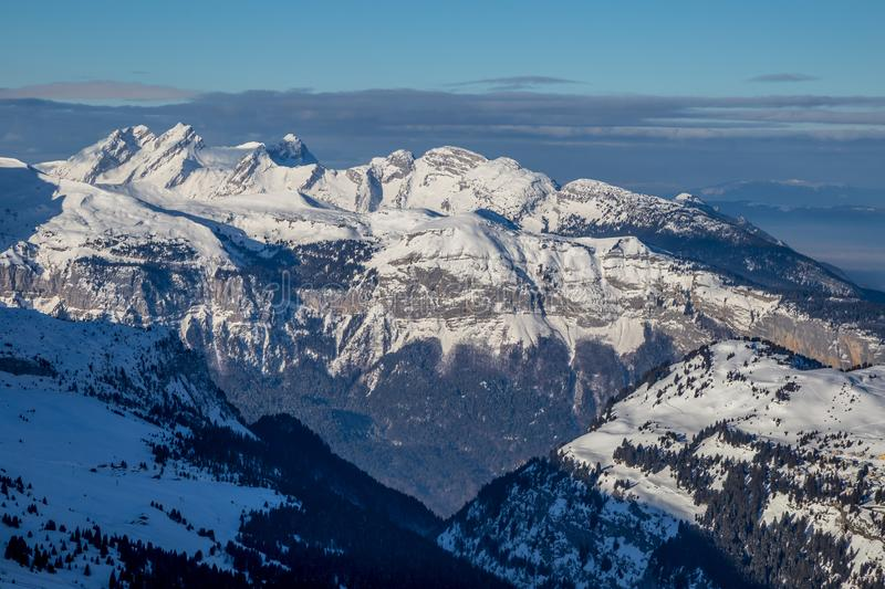 Panorama of winter snowy Alps. Panorama with dramatic sky, Alps in Flaine area, Grand Massif, France royalty free stock photo