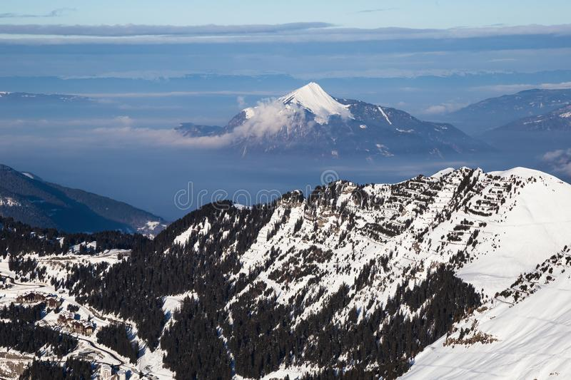 Panorama of winter snowy Alps. Panorama with dramatic sky, Alps in Flaine area, Grand Massif, France royalty free stock photos