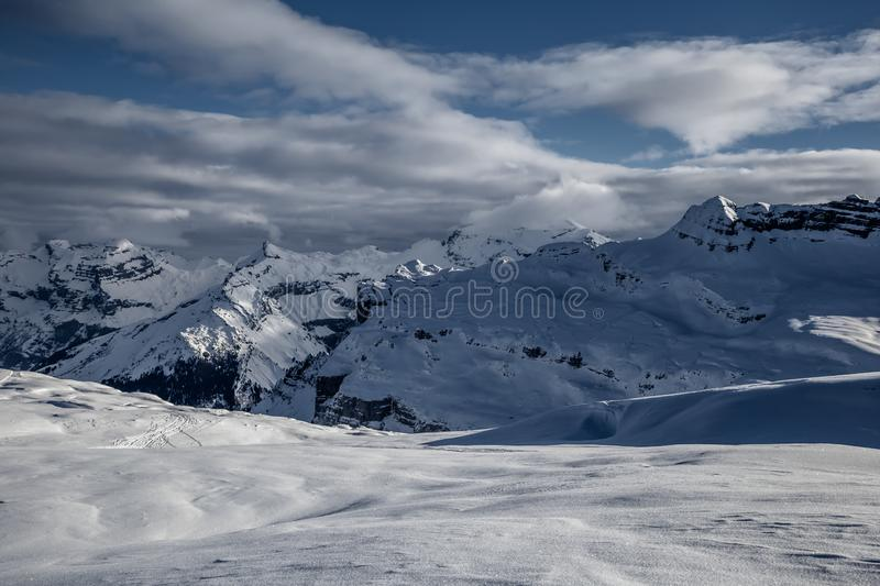 Panorama of winter snowy Alps. Panorama with dramatic sky, Alps in Flaine area, Grand Massif, France stock images