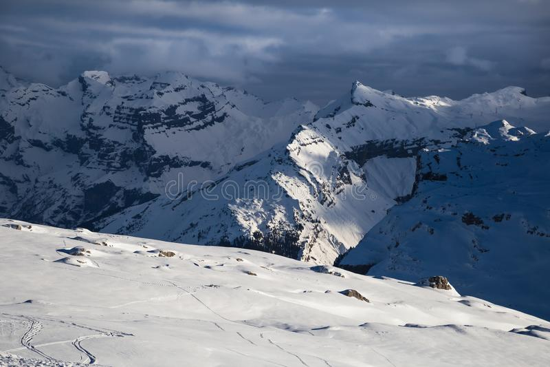 Panorama of winter snowy Alps. Panorama with dramatic sky, Alps in Flaine area, Grand Massif, France stock photography