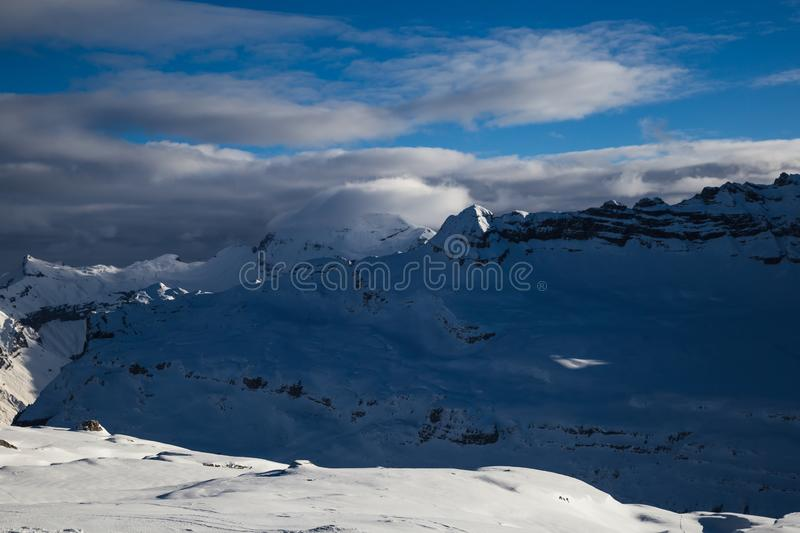 Panorama of winter snowy Alps. Panorama with dramatic sky, Alps in Flaine area, Grand Massif, France stock image