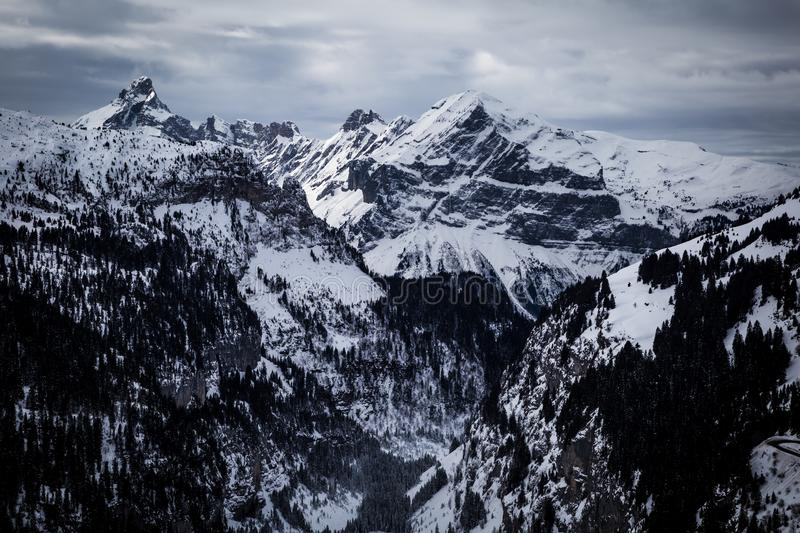 Panorama of winter snowy Alps. Panorama with dramatic sky, Alps in Flaine area, Grand Massif, France stock photos