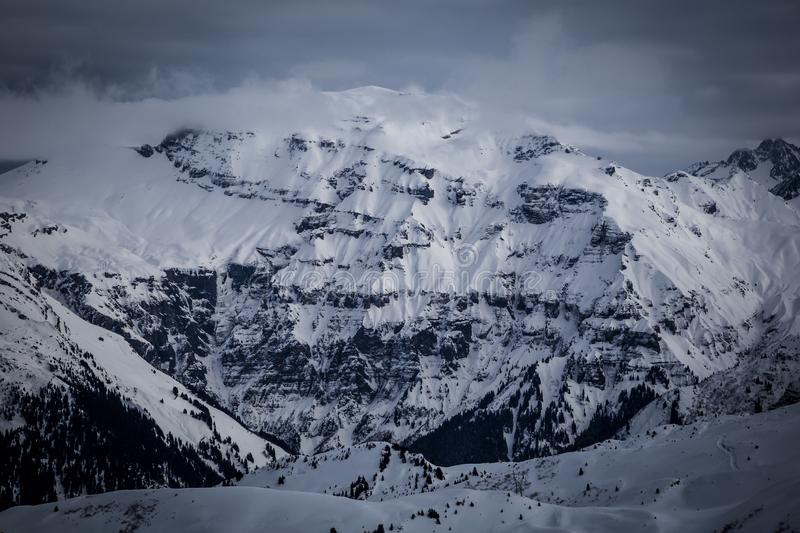 Panorama of winter snowy Alps. Panorama with dramatic sky, Alps in Flaine area, Grand Massif, France royalty free stock photography