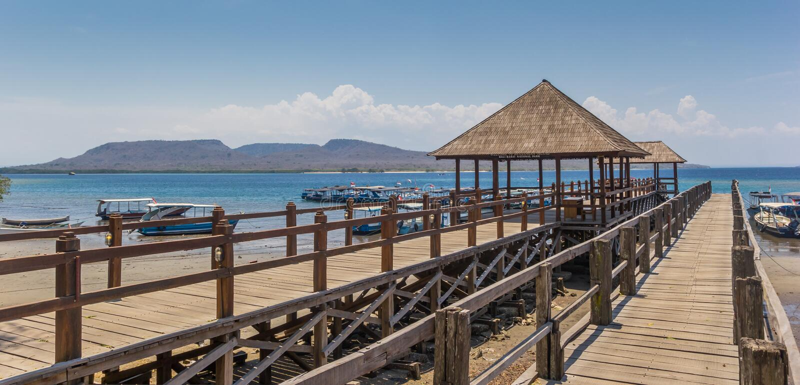 Panorama of a wooden jetty at the Bali Barat National Park. Indonesia stock photography