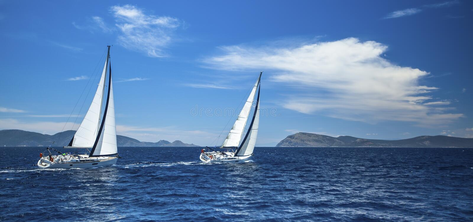 Panorama of the yacht race in the open sea. Sailing. Luxury yachts stock images