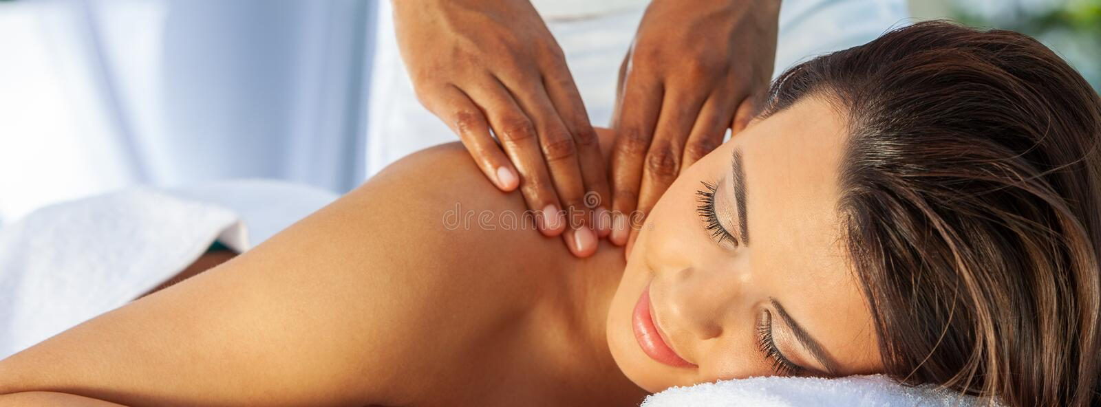 Woman At Health Spa Having Relaxing Massage Panorama Web Banner stock photos