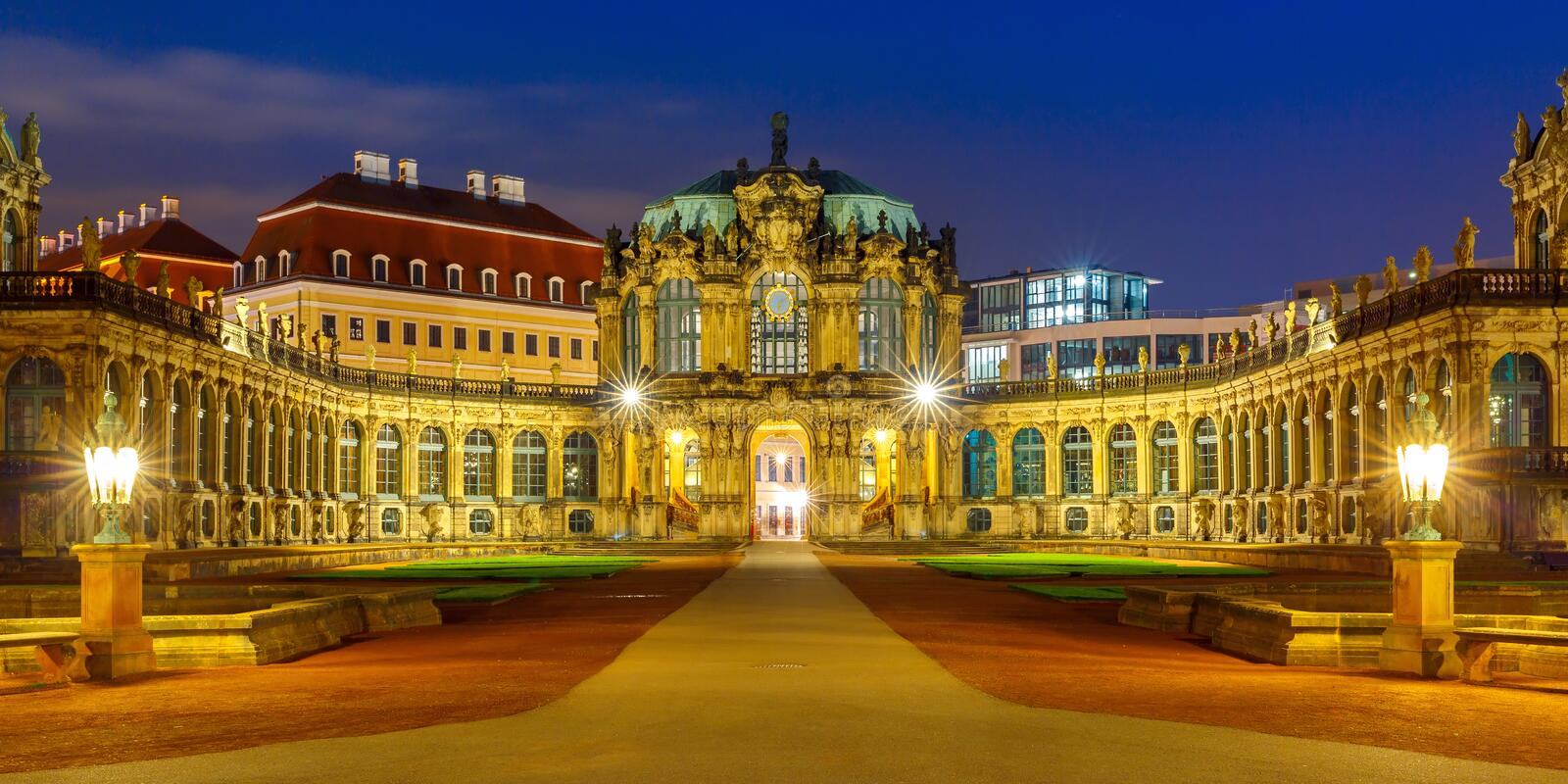 Panorama of Zwinger at night in Dresden, Germany. Panorama of Palace in Rococo style and museum Zwinger at night in Dresden, Saxony, eastern Germany stock photo