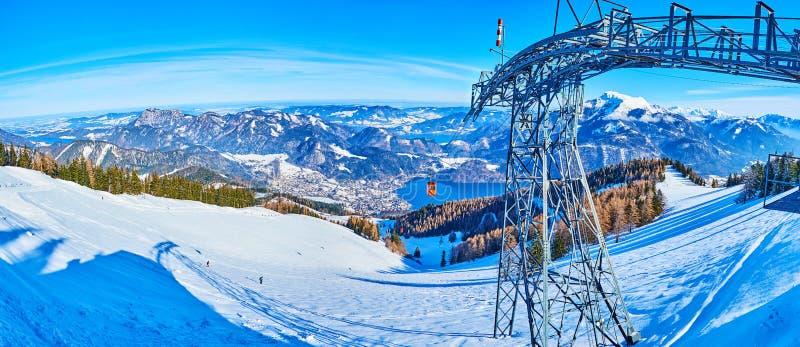 Panorama from Zwolferhorn mount, St Gilden, Salzkammergut, Austria. Watch the snowy Alpine scenery from the top of Zwolferhorn Mount with riding vintage gondolas royalty free stock image
