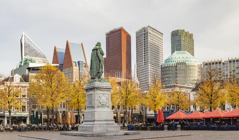 Panorama photo of the statue of William vam Orange on het Plein in the Hague in autumn tones with the sky-line in the background royalty free stock images