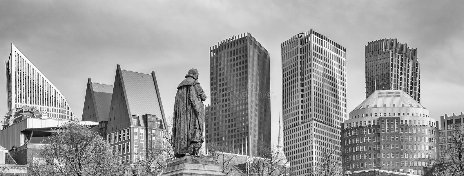 Panorama photo of the statue of William vam Orange on het Plein in the Hague with the sky-line in the background in black and whit. Panoramaphoto of the statue stock image