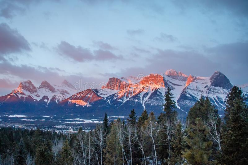 Panoramatic view of mountain range above town of Canmore in Canada. Sunrise view of Canadian rockies, morning in Canadian mountains, bow valley landscape royalty free stock photography