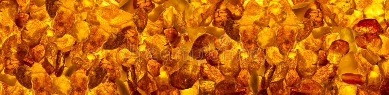 Panoramic сloseup baltic amber stones rectangular lie on a flat surface royalty free stock photos