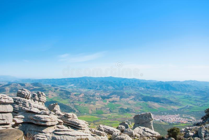 Panoramic aerial top view to a valley, colorful fields and a typical white village from view point at El Torcal natural park on s stock image