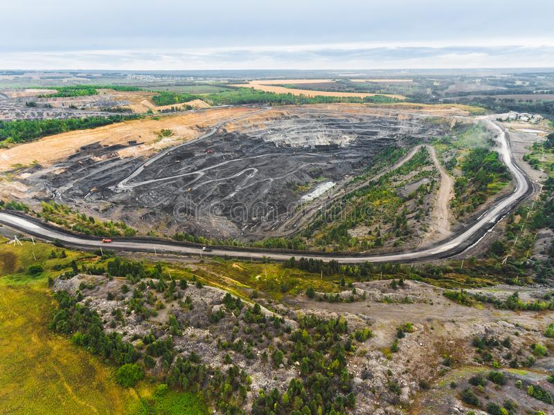 Panoramic aerial view of abandoned coal mine. Canned quarry. Open coal mining, Antarcite mining. Pit on coal mining by open way royalty free stock photos