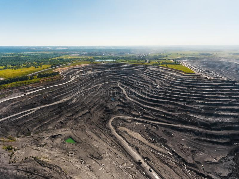 Panoramic aerial view of abandoned coal mine. Canned quarry. Open coal mining, Antarcite mining. Pit on coal mining by open way royalty free stock image