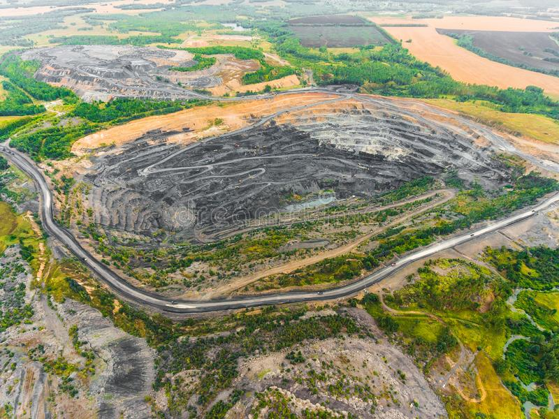 Panoramic aerial view of abandoned coal mine. Canned quarry. Open coal mining, Antarcite mining. Pit on coal mining by open way stock photo