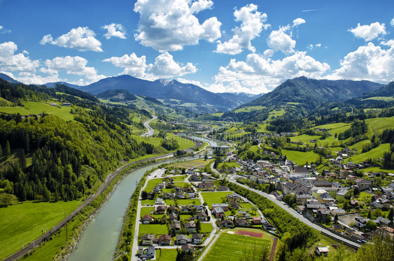 Panoramic aerial view of Alps mountains and village in green val royalty free stock image