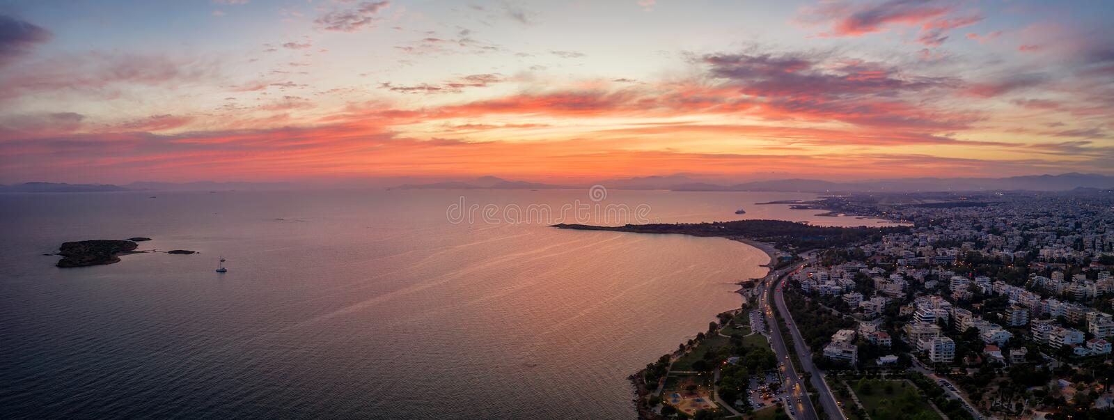 Panoramic aerial view of the Athens Riviera coast, Greece. Panoramic aerial view of the Athens Riviera coast with beaches and restaurants during sunset time stock images