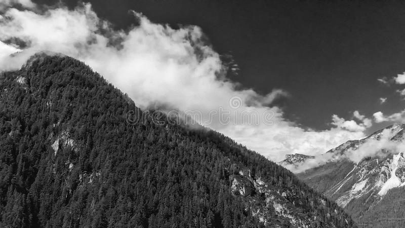 Panoramic aerial view of beautiful alpin mountains scenario stock photos
