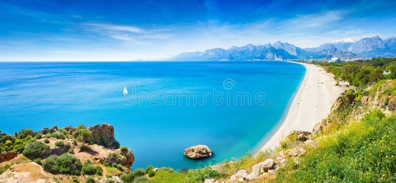 Panoramic aerial view of beautiful blue gulf and long Konyaalti beach in Antalya, Turkey. Antalya is Turkey`s biggest international sea resort located on royalty free stock photography