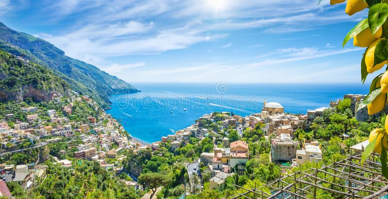 Panoramic aerial view of beautiful Positano with comfortable beaches and clear blue sea on Amalfi Coast in Campania, Italy. Aerial view of Positano with stock image