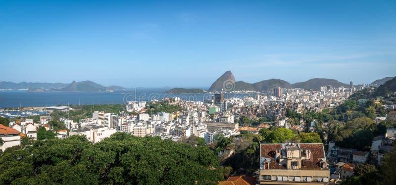 Panoramic aerial view of downtown Rio de Janeiro with Sugar Loaf mountain on background - Rio de Janeiro, Brazil. Panoramic aerial view of downtown Rio de stock photo