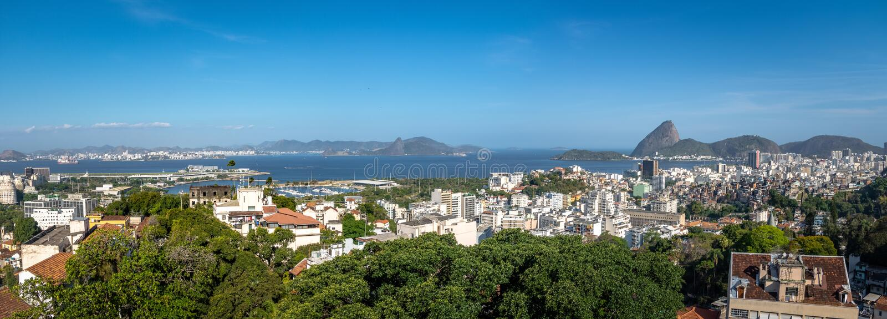 Panoramic aerial view of downtown Rio de Janeiro with Sugar Loaf mountain on background - Rio de Janeiro, Brazil. Panoramic aerial view of downtown Rio de stock image