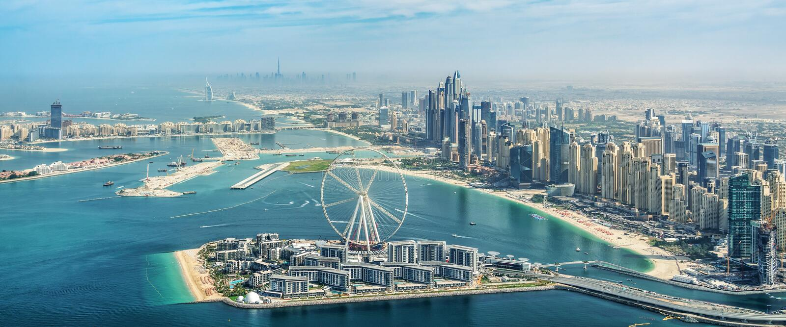 Panoramic aerial view of Dubai Marina skyline with Dubai Eye ferris wheel, UAE royalty free stock image