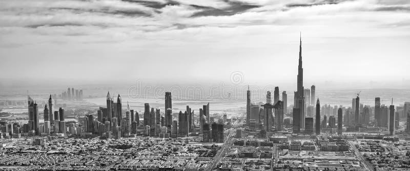 Panoramic aerial view of Dubai skyline in black and white, United Arab Emirates. Panoramic aerial view of Dubai skyline in black and white in United Arab royalty free stock image