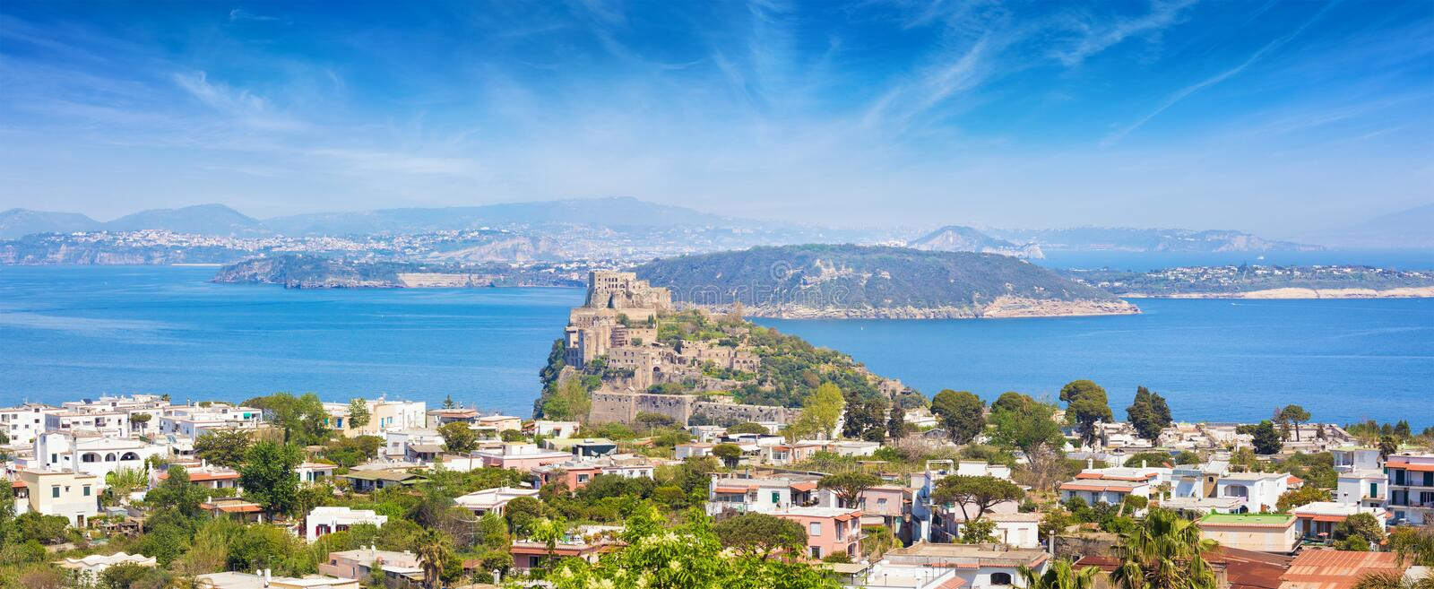Panoramic aerial view of Gulf of Naples, Ischia Island and famous landmark and tourist destination Aragonese Castle or Castello. Welcome to Ischia panoramic royalty free stock photos