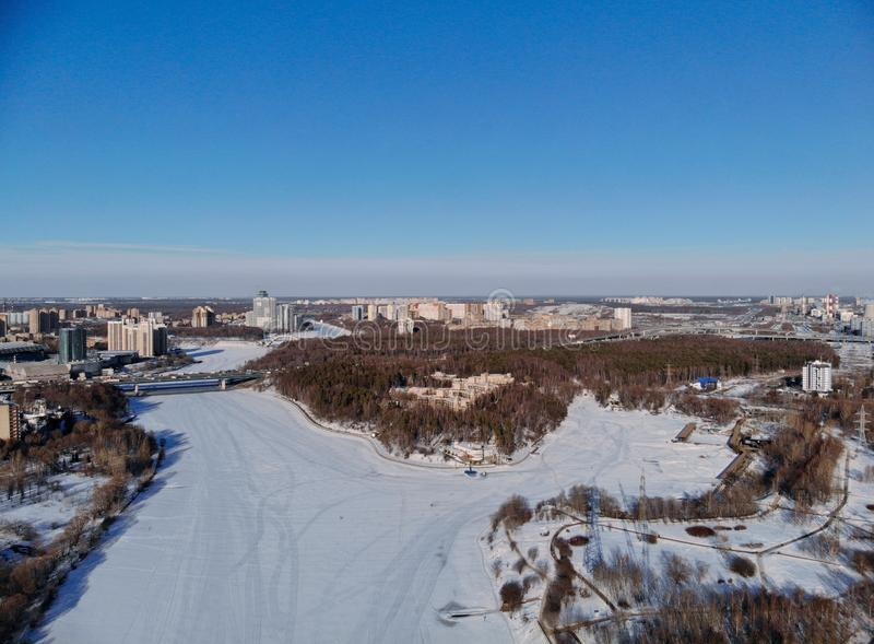 Panoramic aerial view on the Leningradsky Highway on a cold sunny day in winter. Beautiful urban landscape river covered with ice royalty free stock photography