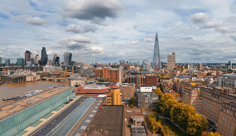 Panoramic aerial view of London skyline on a gloomy overcast day in Autumn. Panoramic aerial view with the Shard, skyscrapers of the City of London and London stock image