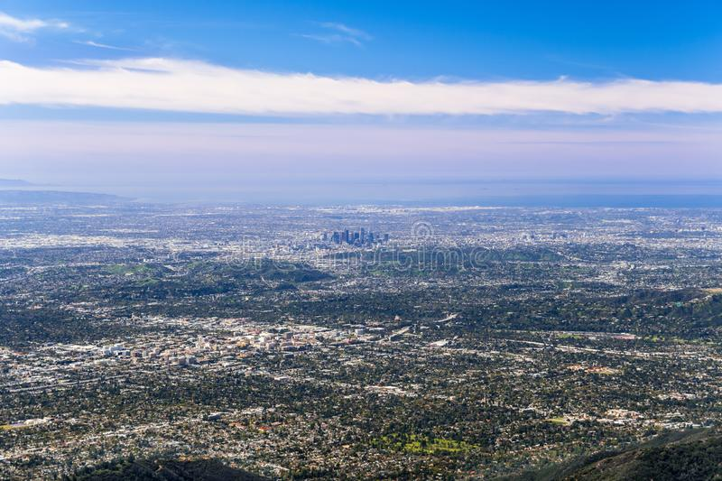 Panoramic aerial view of Los Angeles downtown and the metropolitan area surrounding it; Pasadena in the foreground; Santa Monica. And the Pacific Ocean royalty free stock image